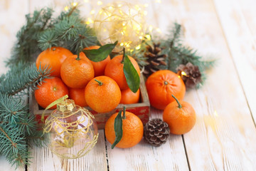 still life with few tangerines, Christmas balls and fir branches,. close up, soft focus