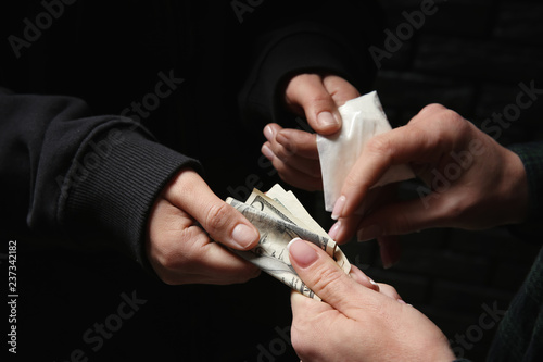 Photographie Woman buying drugs from dealer. Concept of addiction