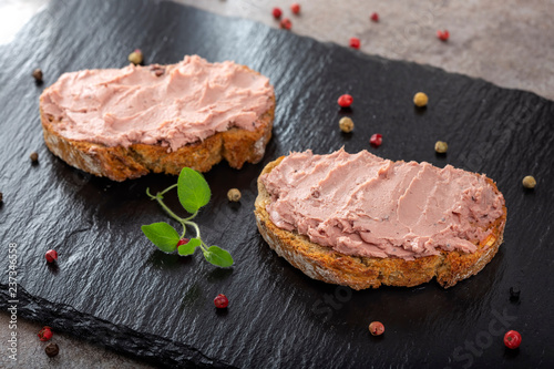 Open sandwiches with pate specialty made from pork and turkey liver with sweet cranberry jam