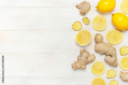 Fotografie, Obraz  Fresh ginger root and lemon on white wooden background