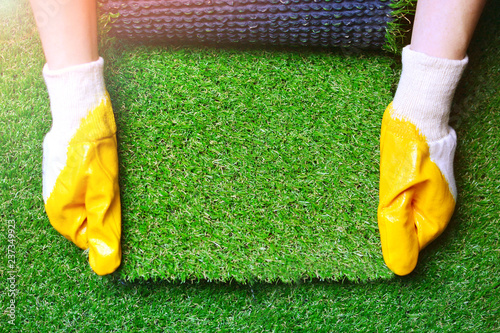 Fotomural Greenering with an artificial grass background