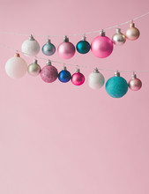 Colorful Pastel Chrstmas Decoration Balls On Pink Background. Minimal New Year Concept With Creative Copy Space.