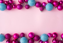 Minimal Composition Background Of Plastic Pink And Blue Decorative Christmas Balls. New Year Concept.