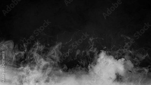 Garden Poster Smoke Rolling billows of smoke mist clouds from dry ice across the bottom light . Fog on floor isolated background black texture .