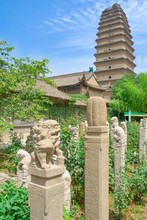 Garden At Jianfu Temple With Small Wild Goose Pagoda In The Background. Xian, China.