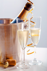 Panel SzklanyPair glass of champagne with bottle in metal container. New Year celebration
