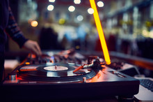 Turntable, Hand Of Dj On The Vinyl Record At Night Club. Blured Background
