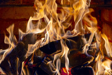Burning Firewood In The Fireplace In The House, Giving Heat And Heat. The Concept Of Heating In The Winter Cold.