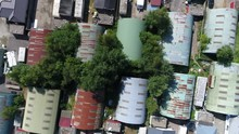 Aerial Top Down View Of Old Rusty Metal Hangers Build Close Next To Each Other Located At Commercial Area The Buildings Have Different Colors Green Dark Red And Blue And Are Used As Workplaces 4k