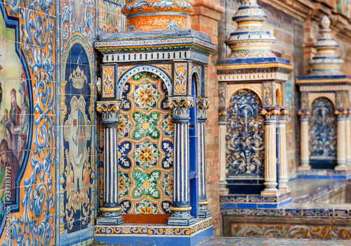 Poster Artistic monument Details of tile columns and walls of the famous Plaza de Espana, example of architecture of Andalusia, Sevilla