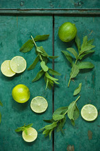 Mint And Limes On Rustic Wooden Background