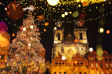 Decorated Christmas Tree Stands On The Main Square In Prague During The New Year Holidays.