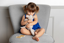 Toddler Girl Giving A Hug To Plush Toy