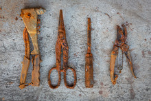 A Set Of Rusty Craftsman Tools Placed On A Weathered Concrete Floor, Top View