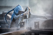 canvas print picture - Sand blasting process, Industial worker using sand blasting process preparation cleaning surface on steel before painting in factory workshop.