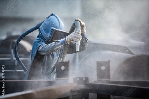 Fényképezés Sand blasting process, Industial worker using sand blasting process preparation cleaning surface on steel before painting in factory workshop