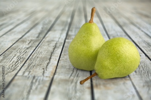 Ripe pears with leaves isolated on white background