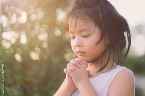 Little girl praying in the morning for a new day Canvas Print