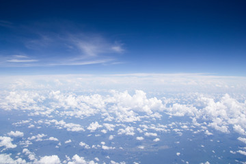 Blue sky cloud background.aerial view abstract beautiful sky over the ocean from airplane window