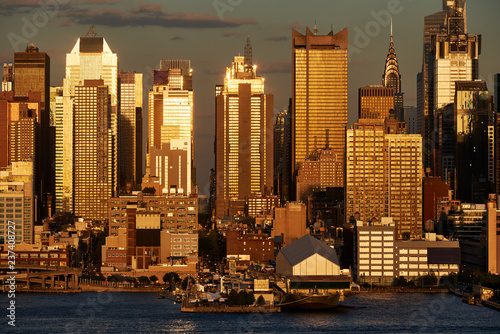 Fotobehang New York City Aerial sunset view of Midtown West skyscrapers from across the Hudson River. Manhattan, New York City, USA