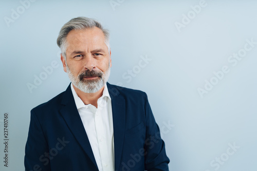 Valokuvatapetti Middle-aged grey-haired man front portrait