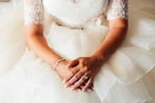 Bride Seated With Hands Crossed At Ceremony