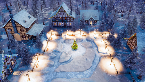 Aerial view of cozy snow covered european village with half-timbered houses and decorated Christmas tree on snowbound square at snowy winter night Tapéta, Fotótapéta