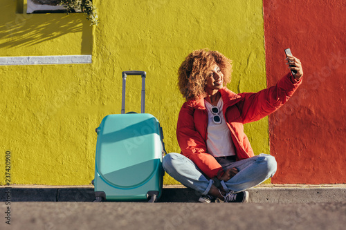 Female traveller taking a selfie outdoors