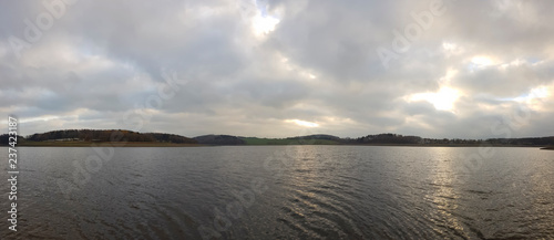 Foto op Aluminium Bos rivier scenic panorama view of sunset under a cloudy sky panorama with sun reflection over water - beautiful scene of a lake while golden sunset / sunrise – sun and clouds reflection over panoramic scenery