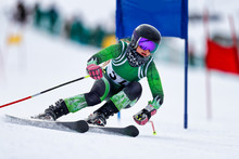A Giant Slalom Skier Rounding A Gate During A Race.