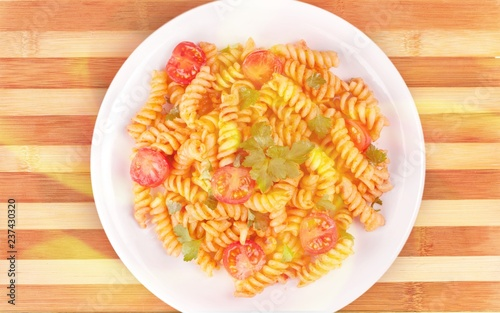 Pasta fusilli with bolognese tomato beef sauce on the kitchen