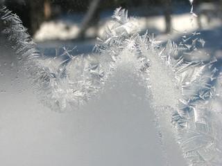 Frosty winter patterns on the glass. Horizontal background.