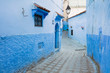 street with turn in blue city Chefchaouen in Morocco