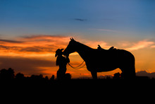 Woman Kissing Horse In Silhoue...