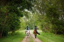 Two Women Trail Riding