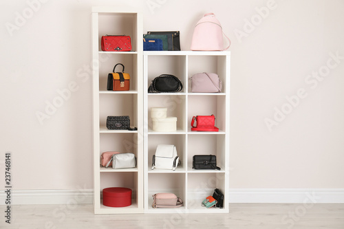 Fotomural Wardrobe shelves with different stylish bags indoors