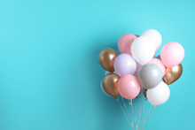 Colorful Party Balloons On Blu...