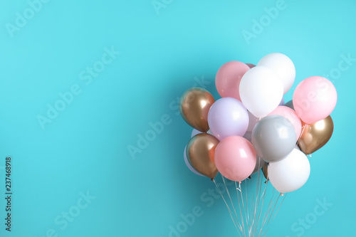 Photo  Colorful party balloons on blue background. Space for text
