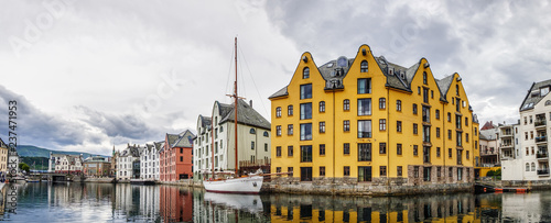 Foto auf Leinwand Stadt am Wasser Yachts and boats at the waterfront of Alesund town, old architecture of Alesund city centre on the background, Norway