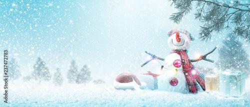 Foto auf AluDibond Licht blau Schneemann - Weihnachtsmotiv