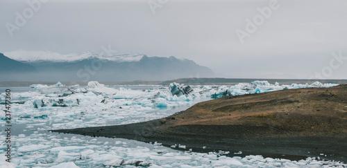 Fotografie, Obraz  Huge blocks of ice on Glacial river and blue icebergs on Jokulsarlon glacier lake