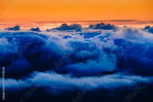 Colline Clouds at sunrise over Haleakala Crater, Maui, Hawaii, USA
