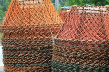 Three Columns Of Crab Traps Stacked On The Wharf.