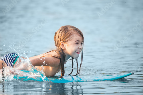 Small kid on a surfboard