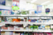 Pharmacy drugstore blur abstract background with medicine and vitamin product on shelves