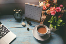 Working Space At Home.Office Desk With Cup Of Coffee,Desktop Laptop,Calendar 2019,clock And Pot Of Rose Flower On Blue Wooden Desk.Urban Lifestyle Concept