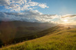 Mountain valley at sunset time, with a beautiful sky. Natural summer landscape