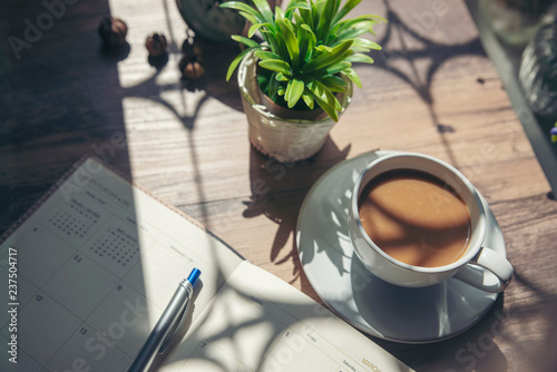 Desktop Calendar 2019 and cup of coffee place on wooden office desk Wallpaper Mural