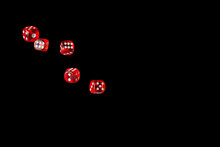 Gambling Game. Rolling Red Dice Isolated Over Black Background With Copy Space.