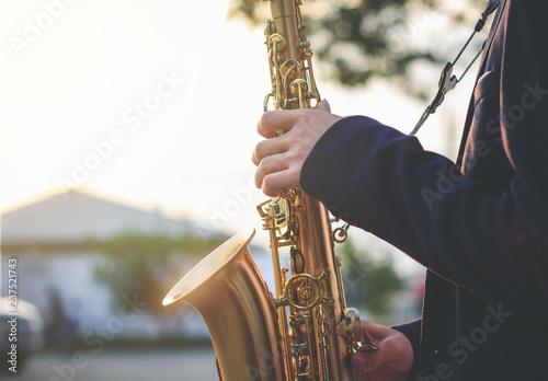 Fotografie, Obraz jazz musician playing the saxophone Beautiful voice / Jazz mood Concept